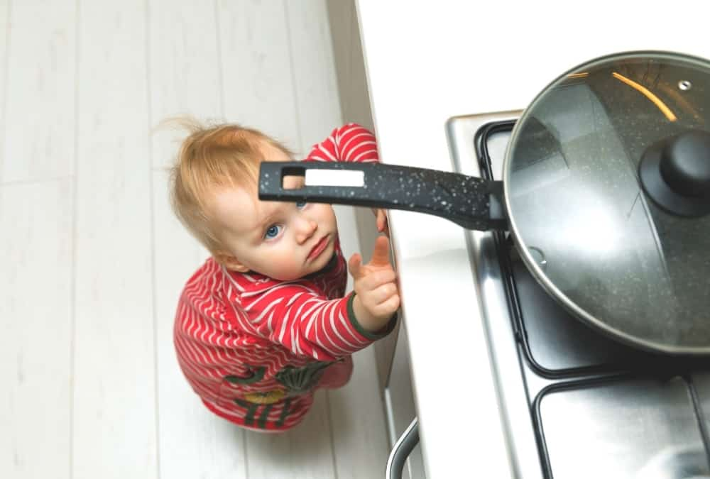 Baby Looking at a hot pan on the stove